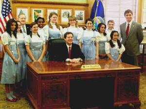 "Kansas Dorothys with Gov. Sam Brownback. This year marks the 75th anniversary of ""The Wizard of Oz"" movie.Courtesy of Seward County Historical Society"