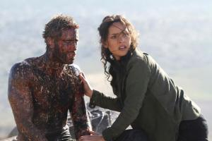 """EMERALD CITY -- """"The Beast Forever"""" Episode 101-- Pictured: (l-r) Oliver Jackson Cohen as Lucas, Adria Arjona as Dorothy -- (Photo by: Rico Torres/NBC)"""